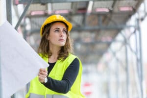 woman construction worker reading plans