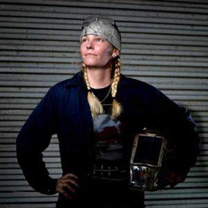 Woman holding welding helmet